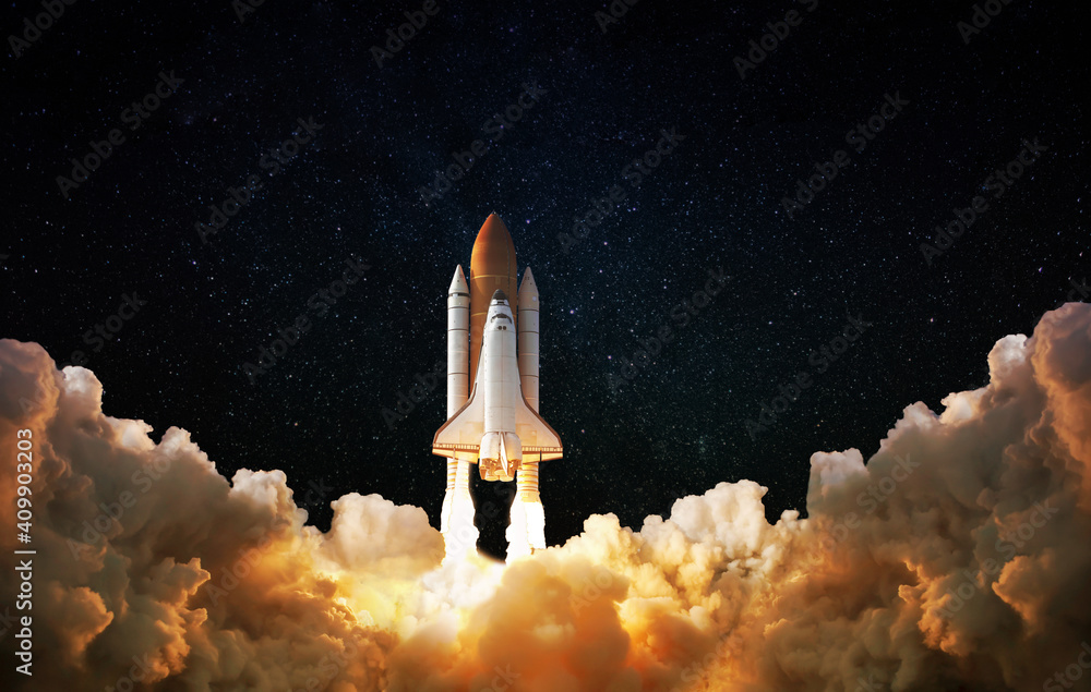 Launch of Space,Spaceship takes off into the night sky.Rocket starts into space concept.Elements of this image furnished by NASA