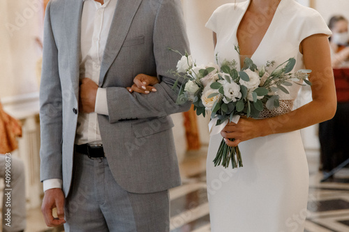 Tela bride and groom holding hands