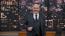 Late-night Talk Show Host Is Performing His Monologue, Looking Into Camera. TV Broadcast Style Show. Model And Property Released For Commercial Use.