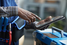 Close Up Of Unrecognizable African-American Worker Using Digital Tablet To Put In Job Details, Copy Space