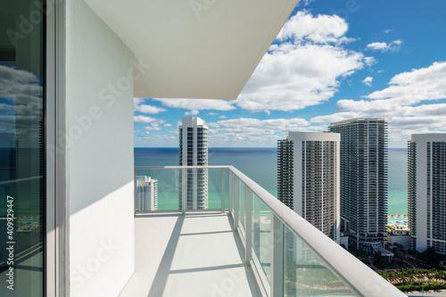 Fotografie, Tablou Luxury condo balcony with coastal ocean water view