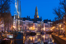 Old Ships In A Canal And The Bell Tower Of The Aa-kerk In The Historic City Centre Of Groningen.