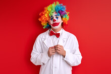 Sad Clown Stand Depressed Having Painted Face Make-up, Crying During Performance, Isolated Red Background