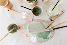 From Above Of Paint Palette With Pastel Pigments Placed On Table With Brushes In Art Studio