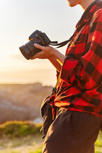 Crop Of Side View Of Unrecognizable Female Traveler With Professional Photo Camera Standing On Hill In Mountainous Area