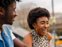 Modern Young African American Couple With Curly Hair Wearing Trendy Denim Clothes Laughing And Looking Away While Standing Together On City Street