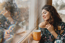 Close Up Sensual Caucasian Woman Wake Up With With A Cup Of Hot Beverage. Beautiful Lady Next To A Glass Windows With Reflections.