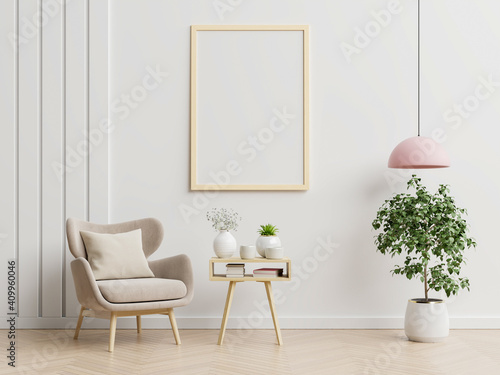 Obraz Poster mockup with vertical frames on empty white wall in living room interior with blue velvet armchair. - fototapety do salonu