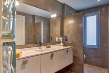 Modern Interior Of Bathroom With Sink In White And Beige Colors In Apartment