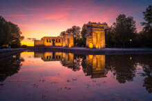Amazing View Of Temple Of Debod Located Near Pond In Madrid At Sundown