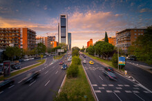 Magnificent View Of Asphalt Road With Traffic Cars At Evening In Madrid