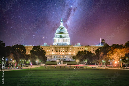 The US Capitol building in Washington D.C. on the National Mall at night with milkyway and stars in the sky. #409965442