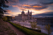 Majestic View Of Almudena Cathedral On Background Of Orange Sundown Sky In Madrid