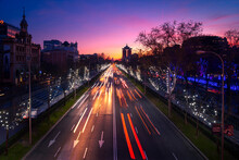 Amazing View Of Red And White Traffic Light Trails On Road In Madrid Under Sunset Sky