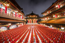 Majestic View Of Illuminated Sanfeng Temple Built In Traditional Oriental Style With Red And Golden Colors In Night Time In Kaohsiung City In Taiwan