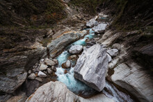 High Angle Of Wonderful Scenery Of Clear River Flowing Among Huge Boulders In Rocky Mountainous Terrain In Hualien City