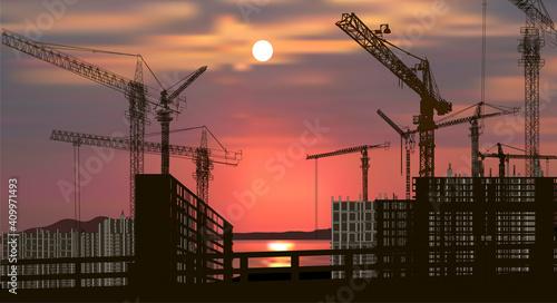 Fotografia nine hoisting cranes near building
