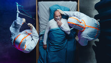 Top View Of Doctors And Covid-19 Patient With Oxygen Mask In Bed In Hospital, Coronavirus Concept.