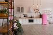 Leinwanddruck Bild - Modern Kitchen Interior with Island, Sink, Cabinets, and Big Window in New Luxury Home.