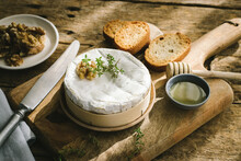Baked Camembert Served On Wooden Table