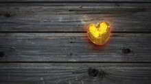 Red-hot Golden Heart Shaped Nugget In A Gray Wooden Vintage Table In Rustic Style, Valentine Day, Wooden Background, Country Style