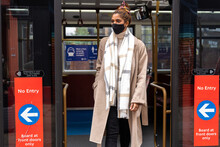Concentrated Young African American Lady In Stylish Clothes And Face Mask Commuting On Public Transport During Coronavirus