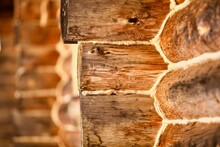 Frame Of The Wooden Log House. Log Cabin Made From Kelo. A Corner Of An Arctic Pine Log House. The Walls Of The Log House Made From Kelo. Saw Cut Of An Arctic Pine Trunk Close-up. Tree Rings Close-up.