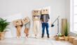 Leinwandbild Motiv Family in funny carton boxes standing in new flat