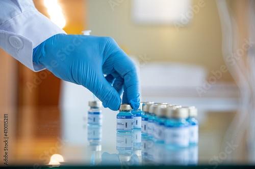 Close-up of COVID-19 coronavirus vaccine vials at the lab. Fighting with the coronavirus pandemic. © Daniel Jędzura