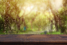 Wood Table Top On Window Glass With Raindrops After Summer Rain. Can Be Used For Display Or Montage Your Products