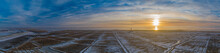 Panorama Aerial Scenic View Of Westerheversand Lighthouse On A Beautiful Evening With Snow And Frost In Winter,North Sea, Schleswig-Holstein, Germany. Dike,salt Marshes, Mudflats In Winter With Snow.