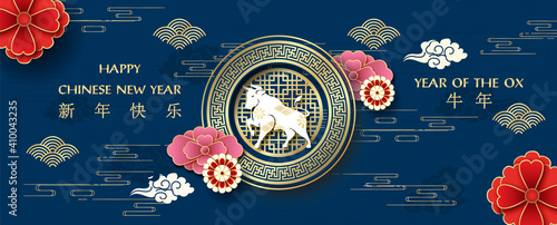 Fotografie, Obraz Chinese flowers decoration with the white Ox Chinese zodiac sign on golden banner and Chinese symbols dark blue background