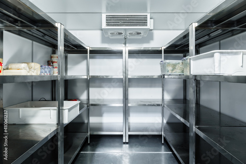 Photo Refrigerator chamber with steel shelves in a restaurant