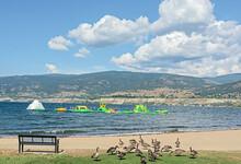 Sand Beach And Water Soaking Attraction On Okanagan Lake