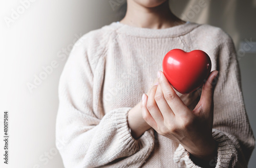 Obraz Red hearts with loving and caring adults. Symbol of support that expresses love valentine day and world heart day, heart health concept - fototapety do salonu