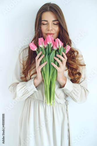 Obraz Beautiful woman with tulips. Spring bouquet in the hands of a young and happy girl. High quality photo. - fototapety do salonu