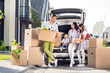 canvas print picture Full size photo of happy smiling family moving dad pack stuff mom and small boy sit car daughter hold package