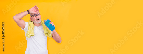 attractive adult man exhausted from sports drinking Wallpaper Mural