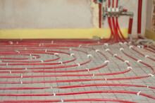 The Red Tubes Of The Underfloor Heating System Are Mounted On The Insulation.