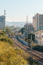 Railways In A Modern Chinese City, Surrounded By Buildings