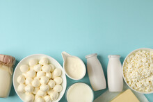 Different Fresh Dairy Products On Blue Background, Space For Text