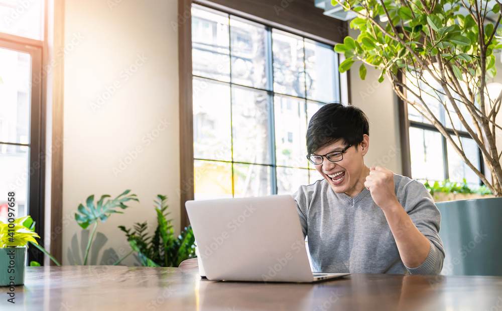 Fototapeta Portrait of smiling handsomel startup business asian man working in office desk using computer. Small business people employee freelance online sme marketing  telemarketing successful banner