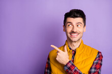 Photo Of Brunette Handsome Young Man Look Point Index Finger Empty Space Feedback Isolated On Purple Color Background