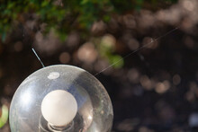 Round Glass Lamp In Form Of Ball On Dark Background