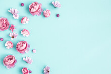 Flowers Composition. Pink Flowers On Pastel Blue Background. Flat Lay, Top View