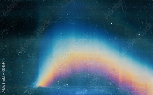 Distressed background. Colorful lens flare. Blue weathered faded stained glass with dust scratches texture smeared dirt blur rainbow light effect.