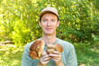 canvas print picture - Man in forest with big Boletus Edulis or Penny Bun mushrooms in hands