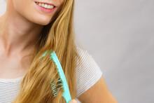 Woman Combing Long Healthy Blonde Hair