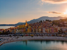 Sand Beach Beneath The Colorful Old Town Menton On French Riviera, France. Drone Aerial View Over Menton France Europe