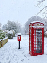British Phone Box And Post Box In The Snow